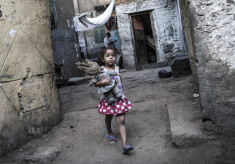 A little girl playing in the alley