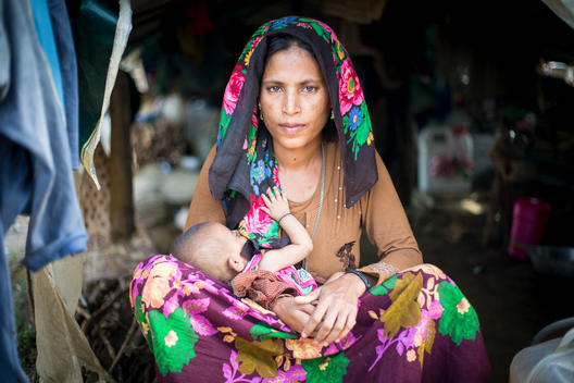 Portrait of woman with 3 months old baby in Refugee Camp in Bangladesh.