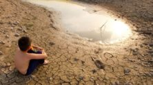 A boy stares at a drought-affected landscape. (Photo: PSI via Twitter)